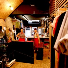 The manufacturing studio provides a backdrop for the retail shop, encouraging customers to consider the whole process of fashion, from design and manufacture through to the finished product.