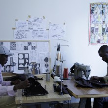 Manufacturing apprentices James and Evariste working in the upstairs fashion school. The pair, who worked together in a factory in Burundi before migrating to Australia, are best friends who love to dance.